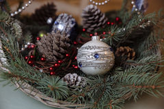 Merry Christmas and New Year decorations, balls, garlands, pine cone in the basket. Concept of holidays Stock Photos