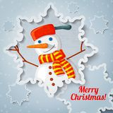 Merry christmas and new year greeting card with. Paper cut out snowflake, and picture of new year snowman with scarf on it Stock Photo
