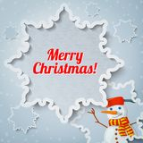 Merry christmas and new year greeting card with. Paper cut out snowflake, and picture of new year snowman with scarf on it Royalty Free Stock Image