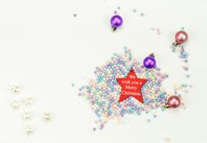 Merry Christmas New Year 2019 holiday composition: beads,red star, 4 Christmas toys, six stars and white background. Merry Christmas Happy New Year holiday royalty free stock photos