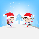 Merry Christmas New Year with smiling boy and girl in , Winter holiday theme blue background Stock Photos