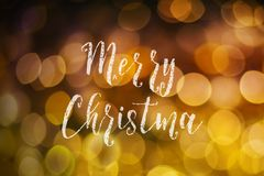 Merry Christmas and New Year typographical on pink gold sparkle. Bokeh or defocus with Xmas card text royalty free stock image