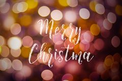 Merry Christmas and New Year typographical on pink gold sparkle. Bokeh or defocus with Xmas card text stock photos