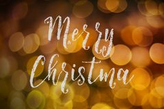 Merry Christmas and New Year typographical on pink gold sparkle. Bokeh or defocus with Xmas card text royalty free stock images