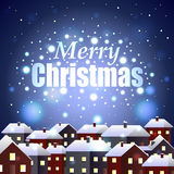 Merry Christmas on night snowy town background Royalty Free Stock Photography