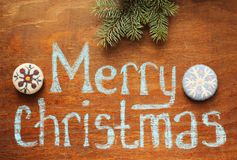 Merry christmas note and branch, ornaments. Merry christmas note and fir tree branch, ornaments Stock Images