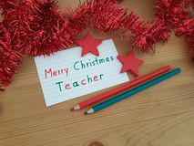 Merry Christmas Note To Teacher With Colored Pencils And Stars stock images