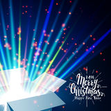 Merry Christmas and Open gift with fireworks from Stock Photo