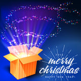 Merry Christmas and Open gift with fireworks from. Light It can be used to design greeting cards Royalty Free Stock Photos