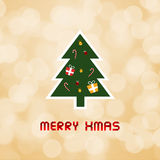 Merry Christmas on orange bokeh background.  Stock Photos