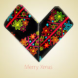 Merry christmas. An origami heart and the sentence merry christmas on a beige background with a retro effect Royalty Free Stock Photo