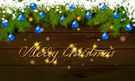 Merry Christmas, panoramic banner. Golden text happy new year Golden text happy new year wooden background balls Christmas tree branches background balls Royalty Free Stock Images