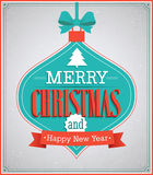 Merry Christmas paper card with hanging toy. Stock Photos