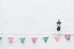 Merry Christmas Party flags bunting hanging on white wall background on x`mas eve holiday event. Minimal hipster style design. royalty free stock photography