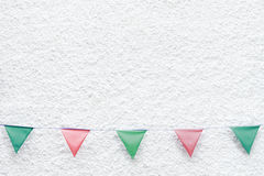 Merry Christmas Party flags bunting hanging on white wall background on x`mas eve holiday event. Minimal hipster style design. Royalty Free Stock Image
