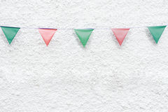 Merry Christmas Party flags bunting hanging on white wall background on x`mas eve holiday event. Minimal hipster style design. Stock Images
