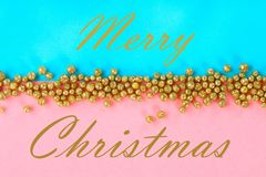 Merry Christmas. Pastel background decorated with shiny decorative stars and balls. Merry Christmas. Pastel background decorated with shiny decorative stars and stock photo