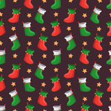 Merry Christmas pattern. Merry Christmas seamless vector pattern with socks and stars Royalty Free Stock Images