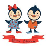 Merry Christmas penguins couple Royalty Free Stock Photography