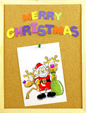 Merry Christmas phrase on a corkboard Stock Image