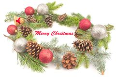 Merry Christmas with pine cones and needles on white Royalty Free Stock Image