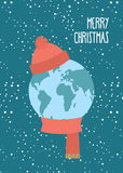 Merry Christmas. Planet Earth winter. Knitted scarf and hat. Sno Royalty Free Stock Photography