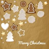 Merry Christmas postcard with gingerbread & cookies on a crumpled paper brown background. royalty free illustration
