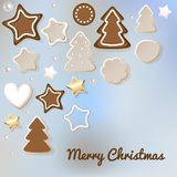 Merry Christmas postcard with gingerbread & cookies on a blue bokeh fog background. royalty free illustration
