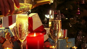 Merry Christmas - Pouring champagne from the bottle - 4 k stock video footage