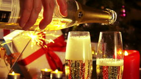 Merry Christmas - Pouring champagne from the bottle - 4 k. New Year and Christmas Celebration. 4 k videos with champagne, candles and christmas tree. Blinking stock video footage
