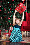 Merry Christmas. Pretty young girl near Christmas tree Royalty Free Stock Photography