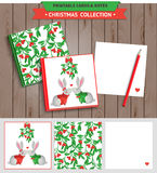 Merry Christmas printable set. Merry Christmas illustration. Vector printable notepad design of cover and papers with kissing rabbits and mistletoe Stock Photos