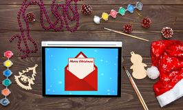 Merry Christmas, received an email on the tablet. Christmas back. Ground template Stock Image