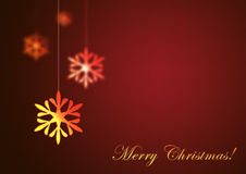 Merry Christmas on red background. Christmas snowflake hanging on red background. Merry Christmas Stock Photos