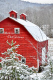 Merry christmas red barn in snow. Red barn with text merry christmas Royalty Free Stock Photos