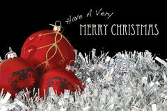 Merry Christmas with Red Baubles on Tinsel Stock Images