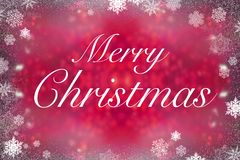 Merry christmas on red shiny background. Merry christmas on red bokeh background Royalty Free Stock Photo
