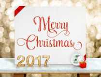 Merry Christmas red glitter text on white paper card with 2017 n Royalty Free Stock Photos