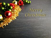Merry Christmas Red Gold an Green with black background. Christmas Card Christmas greetings on blackboard background. With Text `Merry Christmas` and space for stock images