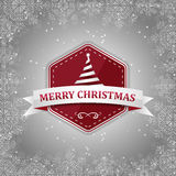 Merry Christmas  red label with Christmas tree, silver ribbon, snow and snowflakes. Stock Photos
