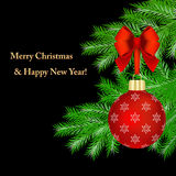 Merry Christmas!. Red Christmas ornaments on fir tree branches against black background. Christmas card Stock Photo