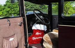 Merry Christmas red stocking decoration. In a car, concept Royalty Free Stock Image