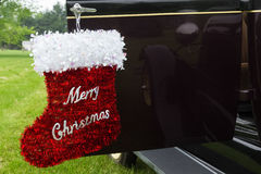 Merry Christmas red stocking,decoration ,car door open as background. Merry Christmas red stocking,decoration ,green grass and car door open as background Royalty Free Stock Photo