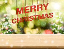 Merry Christmas red text & x28;3d rendering& x29; hanging over wood plank royalty free stock photography