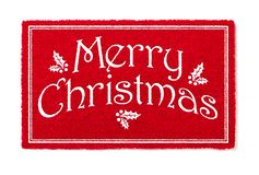 Merry Christmas Red Welcome Mat Isolated on White Background.  royalty free stock photography