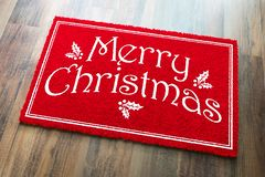 Merry Christmas Red Welcome Mat On Wood Floor Background.  stock image