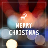 Merry Christmas with reindeer on colorful bokeh background Royalty Free Stock Image