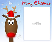 Merry Christmas Reindeer Photo Frame. Reindeer with Merry Christmas Type and Snowflake background with Photo Area Royalty Free Stock Image
