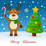 Merry Christmas with Reindeer and Tree. A merry Christmas greeting card with a Christmas tree and a happy reindeer smiling and holding a candy cane in a snowy Royalty Free Stock Photography