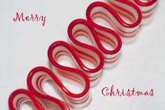 Merry Christmas Ribbon Candy Greeting. This is a delicious red and white striped old fashioned peppermint ribbon Christmas candy and a red & white holiday cup stock image